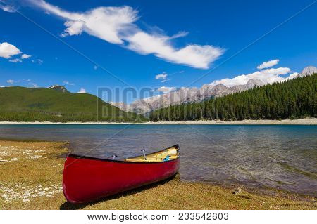 Red Canoe On The Shore Of A Mountain Lake, Peter Lougheed Provincial Park, Alberta