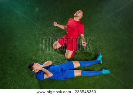 Happy And Unhappy Football Players After Goal At Stadium. The Professional Football, Soccer Player A