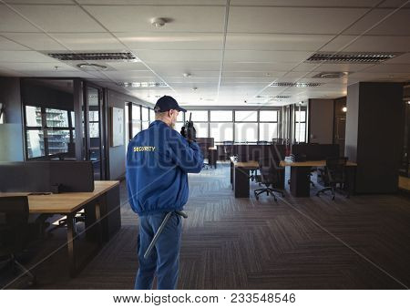 Digital composite of security guard guarding the office