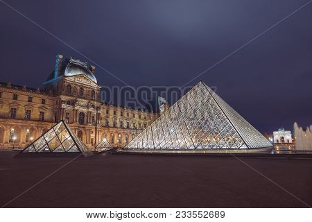 Paris, France - September 30, 2017. View Of Famous Louvre Museum With Louvre Pyramid At Night. Louvr