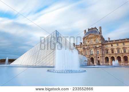 Paris, France - September 30, 2017. View Of Famous Louvre Museum With Louvre Pyramid At Evening. Lou