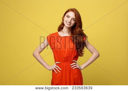 Fashion And Lifestyle Concept: Studio Shot Of Attractive Self Confident Young Female In Great Mood F