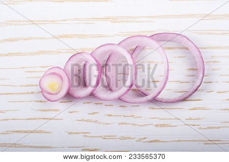 Sliced Onion Rings And  Onion Slices  On The Background