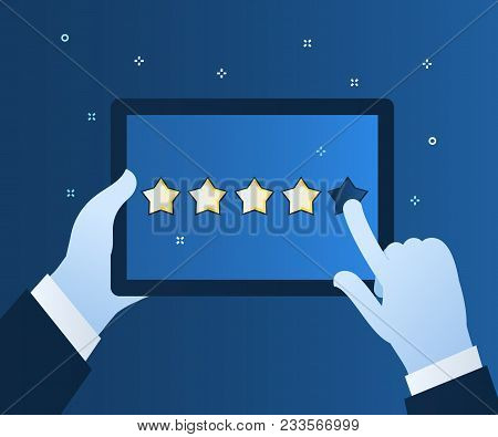 Concept Of Rating. Hands Holding A Tablet Computer With Rating System And Hand Pushing The Star Butt