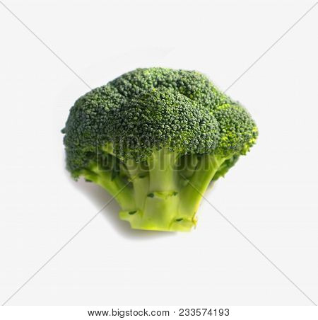 Branch Of Fresh Tasty Green Broccoli Cabbage. Photo Depicts A Bright Colorful Natural Beautiful Deli