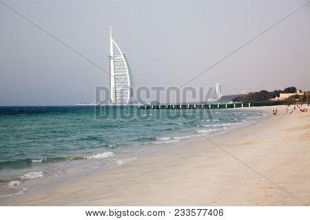 DUBAI, UNITED ARAB EMIRATES - FEBRUARY 2018 : Burj Al Arab, One of the most famous landmarks of United Arab Emirates seen from Black Palace public beach.
