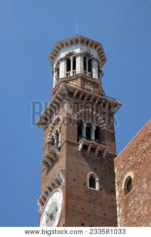 VERONA, ITALY - MAY 27: Torre dei Lamberti - medieval tower of the Lamberti XI century - 84 m. Piazza delle Erbe, UNESCO world heritage site  in Verona, Italy, on May 27, 2017.