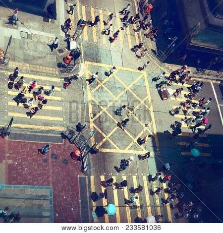 Hong Kong - August 2017: Aerial view of people crossing street at small busy junction in Tsim Sha Tsui. Kowloon