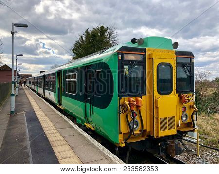 EPSOM, SURREY - MARCH 26, 2018: A stationary British Rail Class 455 passenger commuter train operated by Southern Govia Thameslink Railway at Epsom Downs train station in Epsom, Surrey, UK.