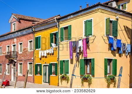 Daylight View To Vibrant House Front Facades With Clothes Drying