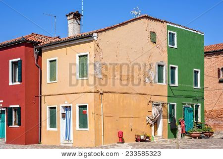 Daylight View To Colorful Buildings With Chimney