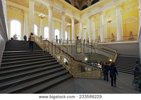 ST. PETERSBURG, RUSSIA - APRIL 24, 2017: People on the main staircase of the Russian Museum. It's the widest museum of Russian art in the world
