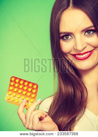 Woman Holding Pills Blister Pack Vitamin C In Hand, Synthetic Way Of Health Care. Studio Shot On Gre