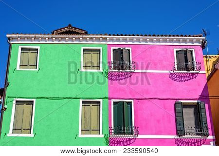 Daylight View To Complementary Colored Mint And Pink Building