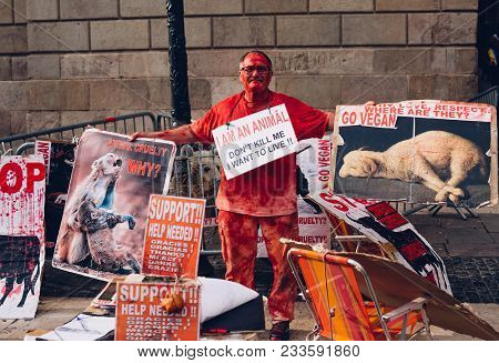 Barcelona, Spain - February, 09, 2018. A Man Urging Not To Kill Animals For Meat On The Street In Th