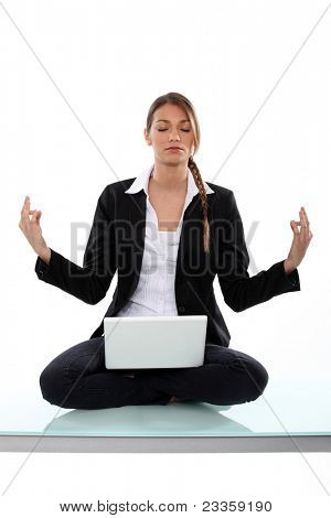 Businesswoman, sat in yoga position