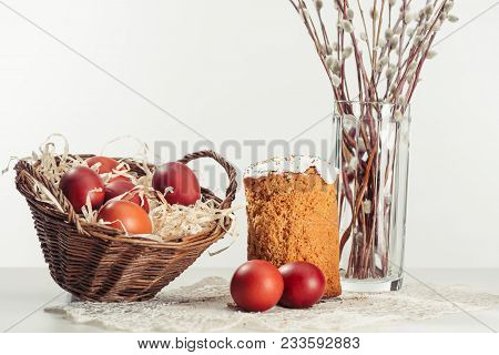 Painted Chicken Eggs In Basket, Easter Cake And Catkins In Vase On Grey