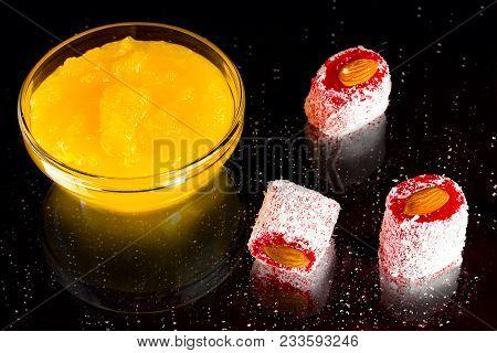 Honey, Rakhat-lukum Sprinkled With Coconut Shavings And Almond On Dark Background, Turkish Sweets