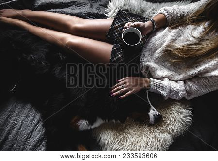 Beautiful Girl Lying And Her Cute Dog Bernese Mountain Dog On Bed, Stylish, Fashionable, Cozy A