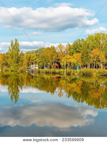 Beautiful Lake With Mirror Reflections In Clear Water On Sunny Day. Tranquil Landscape With Lake, Cl