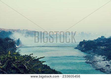 Amazing Landscape Of Bridge Of River, Fog Evaporate From Pond Make Romantic Scene Or Beautiful Bridg
