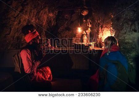 Meditation Lesson In An Ancient Sacred Old Cave Near Rishikesh India. Sadhu, Guru And Spiritual Guid