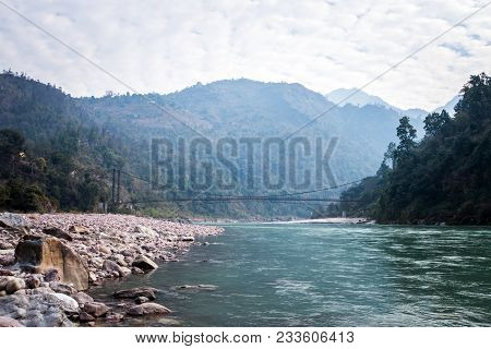 Bridge In The Vicinity Of Rishikesh India. Suspension Bridge Over River. Long Rope Bridge Cross The