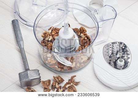 Kernel Walnuts In A Food Processor Ready To Be Crushed For Prepare Dessert