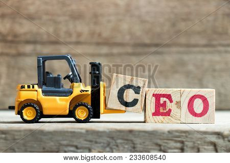 Yellow Toy Forklift Hold Letter Block C To Complete Word Ceo (abbreviation Of Chief Executive Office