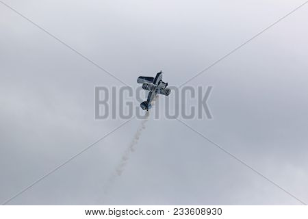 Biplane Flying Doing Aerobatics At An Airshow