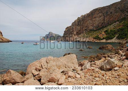 MAJORCA, SPAIN - SEPTEMBER 3, 2017: Boats moored at Cala de Boquer beach on the Spanish island of Majorca. The secluded beach lies at the end of the Boquer valley in the Serra de Tramuntana mountains.