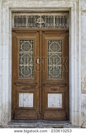 Ancient Wooden Carved Door  With Iron Openwork Patterns Closed, Close-up