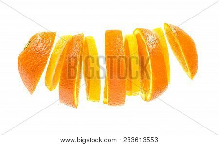 Creative Concept With Flying Orange And Lemon Slices. Sliced Orange And Lemon Isolated On White Back