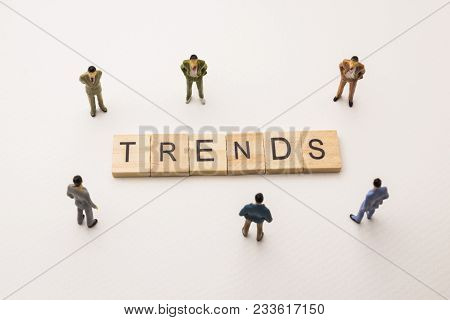 Miniature Figures Businessman : Meeting On Trends Letters By Wooden Block Word On White Paper Backgr