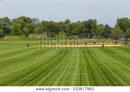 New York, Nyc , Usa - August 28, 2017: Unidentified People Plays Amateur Baseball In Central Park, M