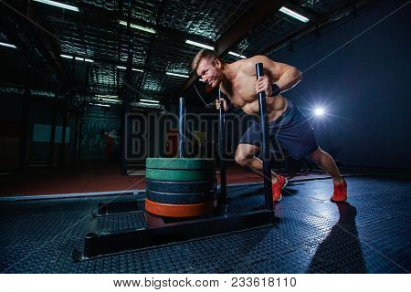 Sled Push Man Pushing Weights Workout Exercise At Gym