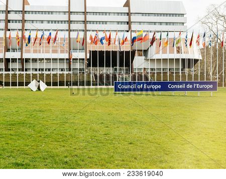 Strasbourg, France - Mar 29, 2018: Council Of Europe Sign, All Eu Flags And Flag Of Russia Flying Ha