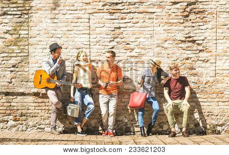 Group Of Happy Excited Friends Having Fun Outdoor Cheering With Guitar - Young People Enjoying Sprin