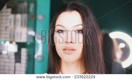 Young Brunette In A Beauty Salon Posing And Looking Into Camera - Close Up Shot