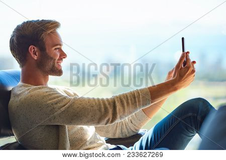 Profile Image Of A Handsome Young Caucasian Man Smiling While Taking A Selfie With His Mobile Phone,