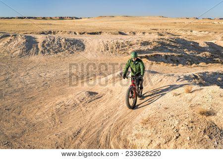 riding fat bike in badlands - Grassland in Colorado