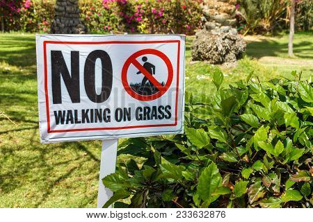 No Walking On Grass Warning Sign In The Garden.