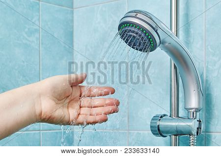 One Palm Of Hand Under Water Jets From Handheld Shower With Slide Bar.