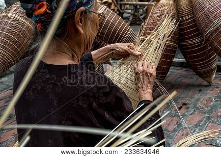 Closeup Old Vietnamese Female Craftsman Hands Making The Traditional Bamboo Fish Trap Or Weave At Th