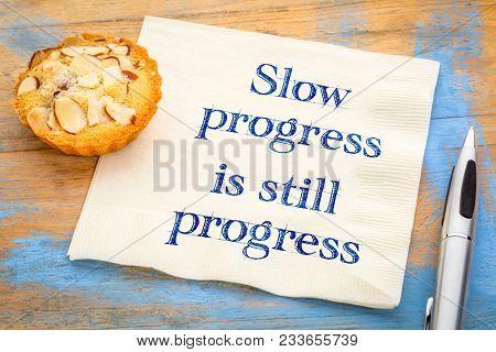 Slow progress is still progress - inspirational handwriting on a napkin