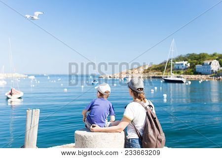Tourists On The Pier Admire The View Of The Sea. Mother With A Young Son Look At The Sea Harbor. Cop