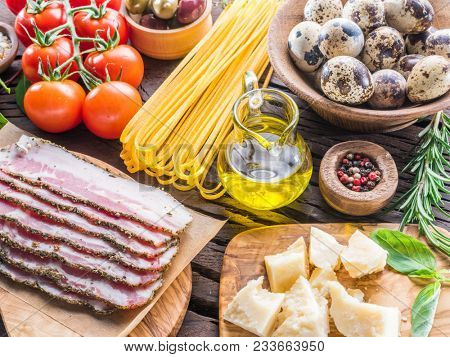 Variety of food on the wooden table. Food background. Organic food.