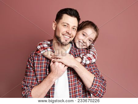 Dad And His Daughter Hugging On Color Background. Father's Day Celebration