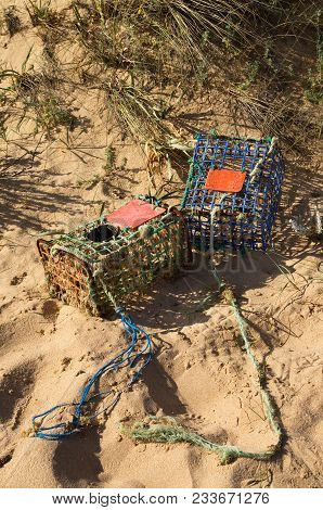 Two Old And Worn-out, Hand Made, Crab Traps Washed Away By Tides And Waves Into The Sand Dunes. Iron