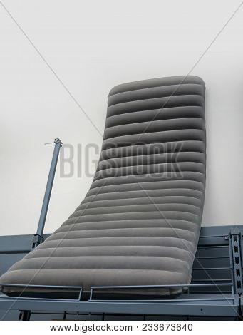 Portable Air Bed For Relax Time Or Outdoor Picnic Display On Metal Shelf In Store